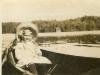 carol-molteno-in-a-birch-canoe-on-the-lake-in-the-adirondacks-1906